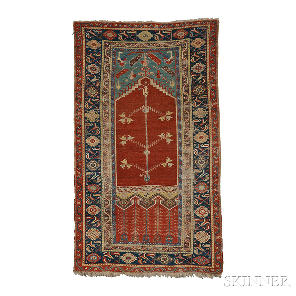 Ladik Prayer Rug, Central Anatolia, late 18th/early 19th century, (areas of wear mostly in oxidized brown areas, some selvage damage, slight end fraying), 5 ft. 10 in. x 3 ft. 6 in.  Estimate $4,000-6,000