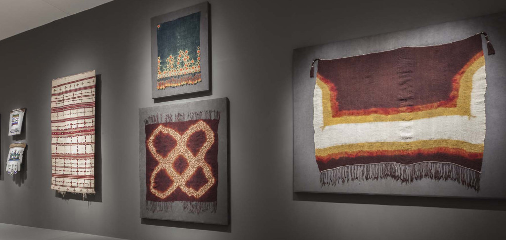 Gallery installation of 'Majestic African Textiles' at Indianapolis Museum of Art showing Zulu beadwork  far left and Moroccan and Tunisian tie-dyed shawls