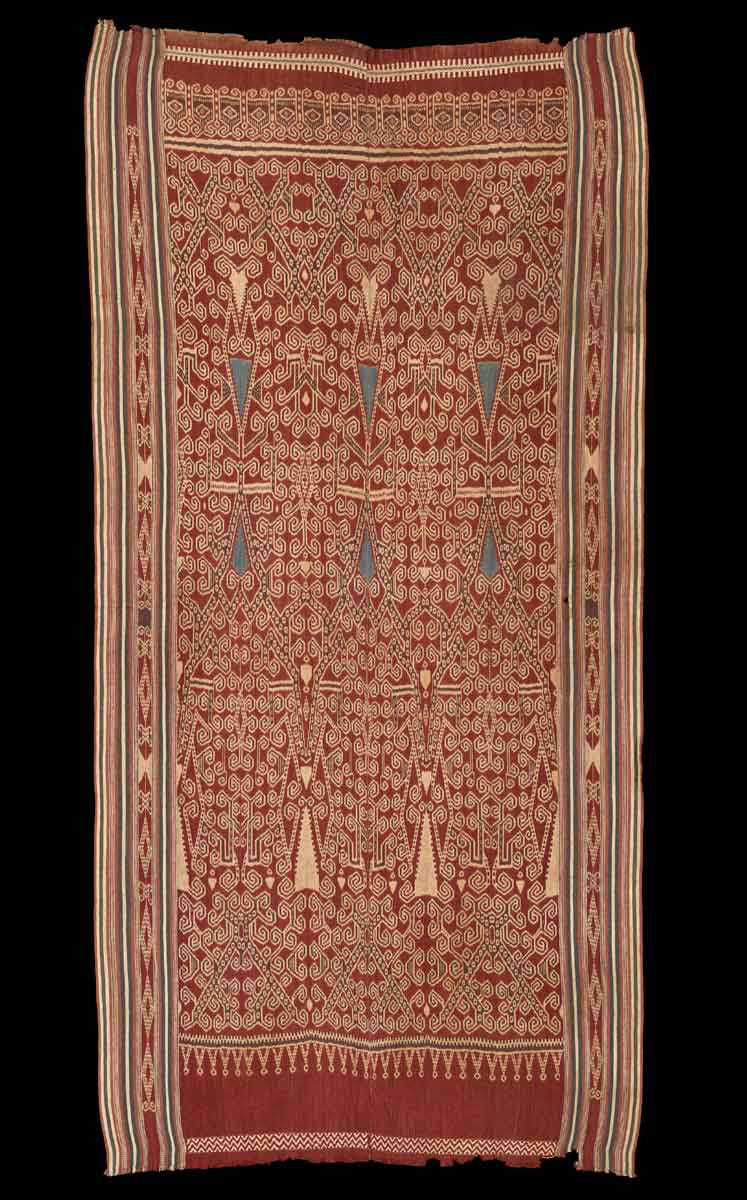 Iban Dayak Pua Kombu (Ritual Cloth) with indigo stylized floral elements, Borneo, late 19th century. Cotton, ikat, 93 x 45 in / 236 x 114 cm