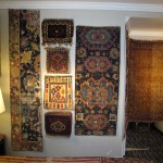 Classical Persian fragments josstle with northwest Persian bagfaces in Michigan dealer Patrick Pouler's room