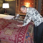 Frank Ames appreciates an Indian Sindh embroidered shawl with Owen Parry, Wales