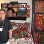 Andy Hale, Anahita Gallery, Santa Fe with his collection of Central Asian textile art