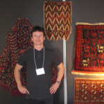 Andy Lloyd from Bath's Haliden in front of his  Turkmen chyrpy and impressive Baluch bird bag