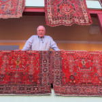 New England John Collins with a pair of Sarouk rugs