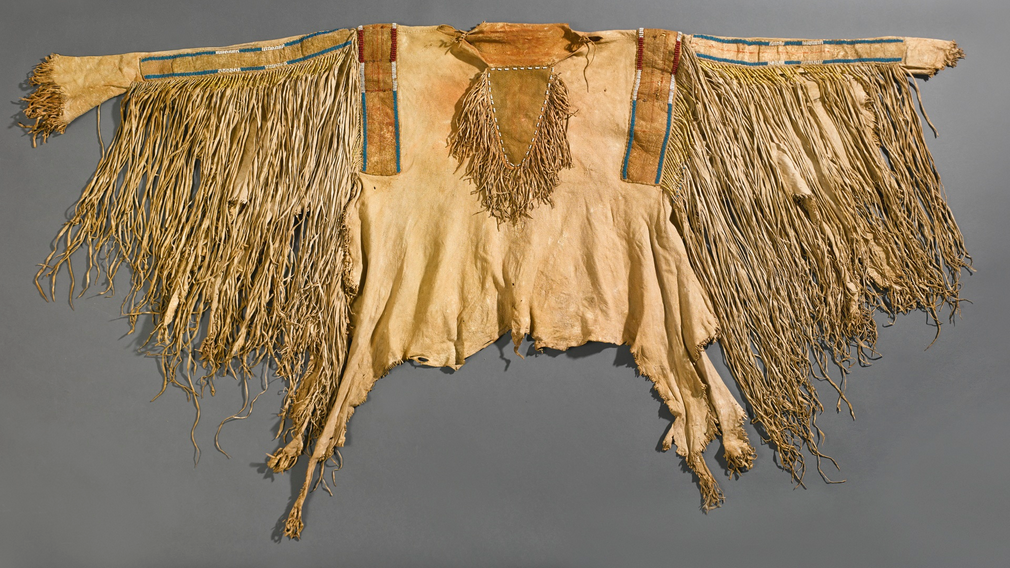"Warshirt, Crow or Nez Perce, hide, porcupine quills and glass beads, 75"" across Lot 104, estimate $40,000 - 60,000"