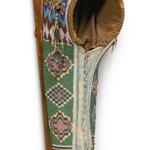 "Cradle, Kiowa, hide and glass beads, length 29"" Lot 16, estimate $75,000 -125,000"