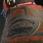 "Clan hat (detail), Northwest coast, cedarbark, abalone, wool, shell, ermine fur, hide, and glass and brass beads, 19 3/4"" x 13 1/2""