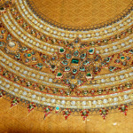 Baan Tha Sawang embroidery.  Green sequins are made from beetle wings