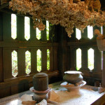 Traditional kitchen with bundles of garlic hanging overhead at the Pa-Da Textile Museum