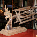 Old wooden silk reeling spool, and holder in the form of a Naga
