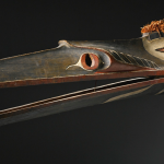 "Mask, Kwakiutl, polychromed wood, cedar bark, 57 1/2"" length Lot 80, estimate $100,000 - 150,000"