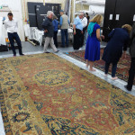 The group are invited to get up close to a Sangusko medallion hunting carpet and a garden carpet at the Clothworkers' Centre at Blythe House in Olympia, London