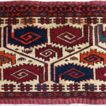 Tekke Turkmen kapunuk (detail), early 19th century,  the Clothworkers' Centre at Blythe House in Olympia, London. 207-1908. Although recognised as Tekke, the colour and handle are also consistent with a Saryk attribution but structurally there are only a few symmetric knots