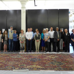 Hali UK Tour group lined up along a Sanguszko vase carpet at the Clothworkers' Centre at Blythe House in Olympia, London