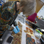Hillary Dumas unrolls carpet fragments from the May Beattie archive at the Ashmolean Museum, Oxford