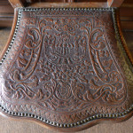 Tooled leatherwork chair seat at Boughton House, Northamptonshire