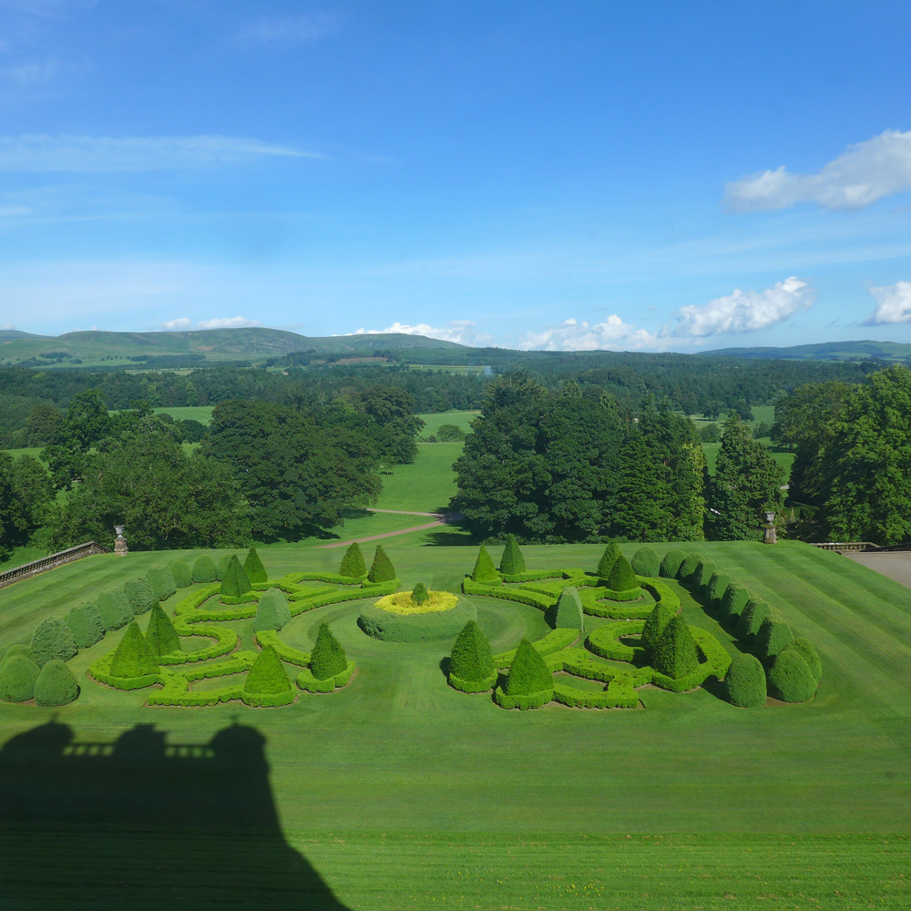 Formal gardens seen from the window of Drumlanrig Castle, Dumfries & Galloway, Scotland