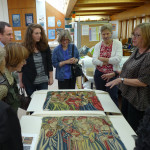 Textile conservator presents tapestries to Lee England, Hillary Dumas, Christie's Lucinda Willan, HALI's Ben Evans and Corinne Berezuk at the Burrell Collection in Glasgow