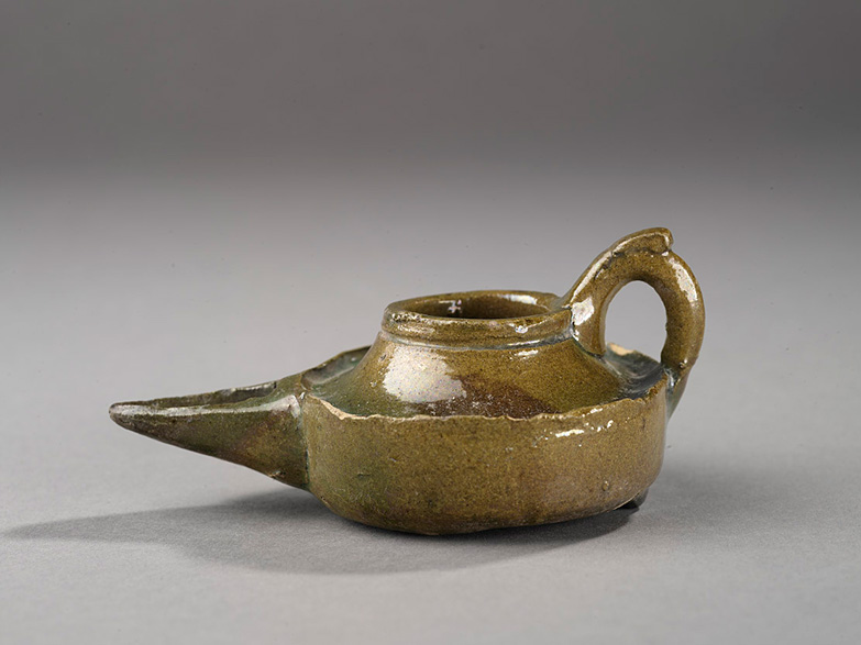 Saucer lamp, Earthenware, thrown, modeled and glazed, Egypt, 12th century