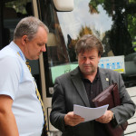 Tour organiser Peter Bichler (right) talks with coach driver, Wolfgang