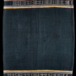 "Wela (sarong, detail), Solor Archipelago, Lembata, Kedang region, 1925–1940. Cotton, three panels, 0.67m x 1.92m (2'2"" x 2'6""). A dowry sarong to be given to the groom's family in exchange for male items. These were much longer than standard sarongs and worn only on ceremonial occasions. A taboo on weaving in the Kedang area of Lembata, respected until roughly the end of the colonial period, would suggest this piece was woven elsewhere. It seems likely that it may have been produced in Kalikur"