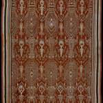 "Pua kumbu, Borneo, Sikka, Iban Dayak, circa 1930. Cotton, two panels, 1.39m x 2.27m (10'1' x 7'5""). A coarse, heavy cloth with large engkaramba figures with labyrinth faces that represent antu – giant ghostly creatures of power, protection and influence that are associated with deities and ancestors. Human figures with elaborate feather headdresses appear to be carrying bundles of skulls with other heads at their feet. It is a cloth with strong headhunting associations"