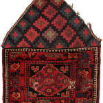 Pile khorjin recycled as saddle rug, Kurds of the Sauj Bulagh area, Northwest Persia, Circa 1850, 63 x 43 cm (25 x 17 in.)