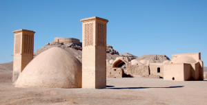"Zoroastrian Towers of Silence for ""sky burials"" (on hilltops) and cooling wind towers for underground reservoirs (foreground) outside of Yazd"