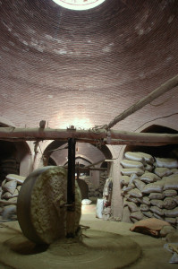 A huge motorized grinding stone in a henna mill in Yazd