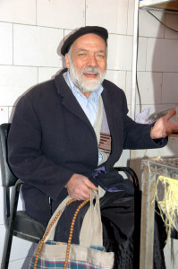 A bakery patron sings for us as he waits for his taftun bread in Abeyaneh