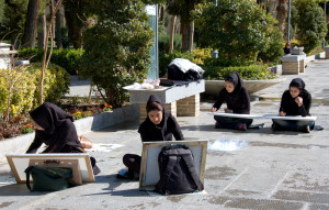 University-level art students drawing the Chehel Sotoun pavilion from the garden, Esfahan