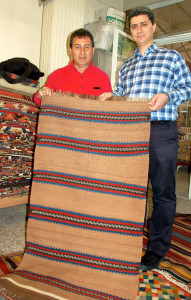 Vedat and the dealer examine a flatweave
