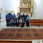 The HALI Tour group with the 15th-century Spanish 'Holbein' carpet, Monasterio de Santa Clara, Medina de Pomar