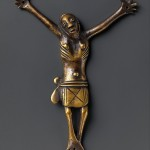 Figure of Christ, 18th–19th century, Kongo peoples, brass; H. 4 3/8 x W. 4 1/2 x D. 7/8 in. (11.1 x 11.4 x 2.2 cm) The Metropolitan Museum of Art, New York, Gift of Ernst Anspach, 1999 (1999.295.3)