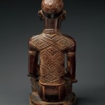 Master of Kasadi, Seated Female Figure with Child, 19th century (before 1898), Kongo peoples, Yombe group,  Wood, glass, kaolin; Height: 10 13/16 in. (27.5 cm), The Metropolitan Museum of Art, New York, James J. and Laura Ross, New York (TR.103.2.2014)
