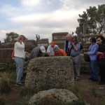 Looking at pictorial motifs on one of the oldest tombstones in Noradouz Cemetery, Armenia