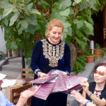 Tatev Muradyan distributes farewell gifts at the Silk Road Hotel, Yerevan, Armenia