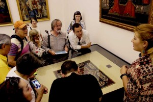 Tatev Muradyan presents an Armenian embroidery in the museum at the Holy Mother See, Etchmiadzin, Armenia
