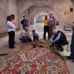 The HALI Tour get a close look at a 17th century Dragon rug, Museum of Sardarapat, Armenia