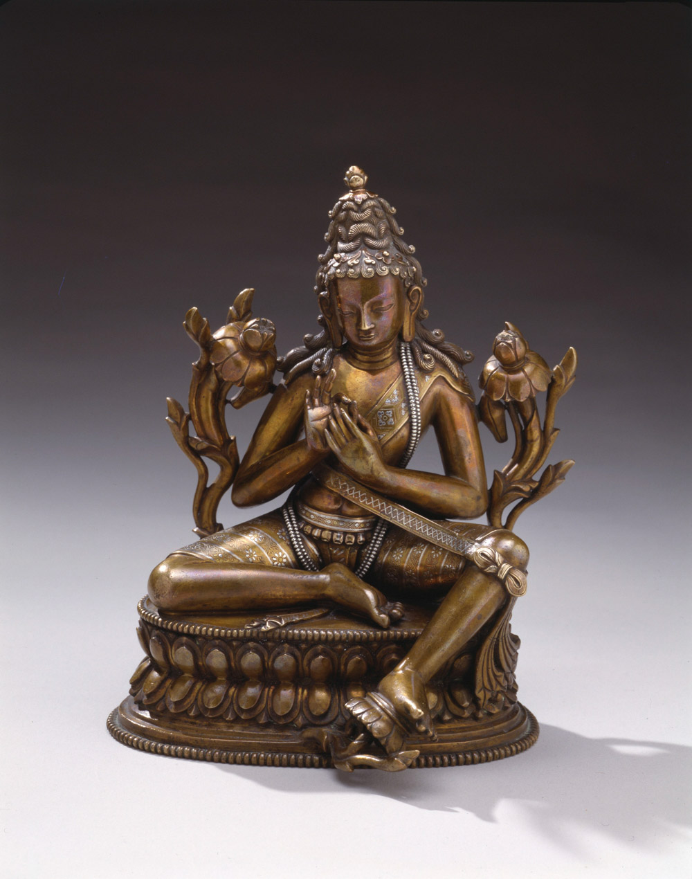 Bodhisattva with meditation belt. Tibet, 2nd half of the 13th century. Copper-alloy with silver and gold inlay. Credit: Collection of the Newark Museum 79.442.