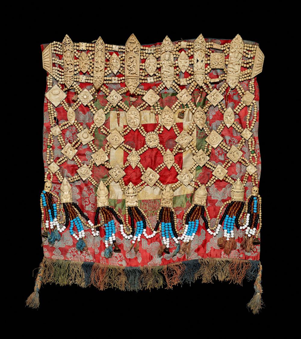 Bone Apron. Human bone, silk, glass. Tibet, 19th century. (c) The Trustees of the British Museum.