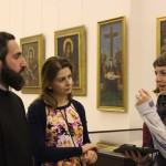 Rachel Meek discusses items in the Etchmiadzin treasury with Father Asoghik