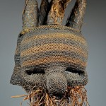 Salampasu Idangani Society 'Mufuampo' mask , Democratic Republic of Congo. Unlike other tribes of the savanna, the Salampasu's use of masks was unique. Through mask ownership, personal status, property gains and individual reputations flourished. Young Salampasu men were not apprentice farmers or hunters, but apprentice warriors. This particular old Mufuampo (raffia) mask is from the Idangani society. It most likely portrays a female character with five horns representing an old hairstyle once popular among Salampasu women. Horns were made of split palm reed and woven fibre, then attached. Woven fibre, pigment, height 35.5 cm  Provenance: Collection of Morton and Rebecca Lipkin, Arizona. David Malik