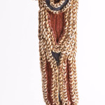 Karahut Breast ornament, Abelam people, North of the Middle Sepik River, New Guinea. An initiated man wore his karahut on his backduring festivities. The ornament is made of pig's teeth and nassa shells fixed to a frame which has the shape of a human being. Acquited in the 1970s. Gallery Lemaire