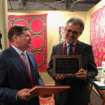Bruce Baganz, chair of the Trustee of the Textile Museum at George Washington University, ,awards gallerist Mehmet Cetinkaya from Istanbul the Joseph V. McMullan Award for Stewardship and Scholarship in Islamic Rugs and Textiles, which is presented annually by The Near Eastern Art Research Center