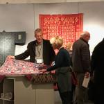 Sante Fe textile specialist John Ruddy showing a client a Javanese batik