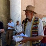 Wilfried Stanzer passes around Cornes de Gazelle pastries at Bab Mansour City Gate, Meknes