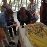 Corinne Berezuk shares her knowledge of stitches with Angela Rutherford and Bob Cadry over a Tetouan embroidery, El Kholti Collection, Rabat