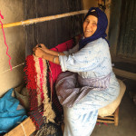 The mother of Mustapha Hansali demonstrating the 'Berber knot' in her home studio, (photo Paige Albright)