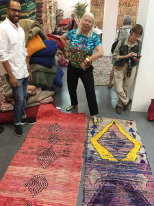 Tour guests Helen Marden and Corinne Berezuk deliberate over vintage Azilal rugs with Ismail Mouahid at the Soufiane showroom, Marrakesh, (photo Paige Albright)